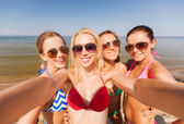 Group of young smiling women making selfie — Stock Photo
