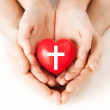 Couple hands holding heart with cross symbol — Stock Photo #51606741