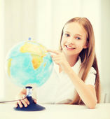 Student girl with globe at school — Stock Photo