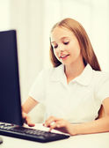 Student girl with computer at school — Stock Photo