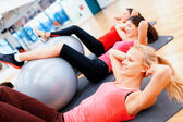 Group of people working out in pilates class — Stock Photo