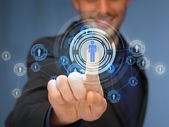 Businessman pressing button with contact — Stock Photo