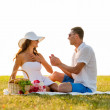 Smiling couple with small red gift box on picnic — Stock Photo #51617945