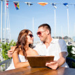 Smiling couple with menu at cafe — Stock Photo #51618103