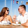 Smiling couple eating dessert at cafe — Stock Photo #51618147