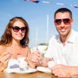 Smiling couple eating dessert at cafe — Stock Photo #51618197