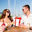 Smiling couple with gift box cafe — Stock Photo #51618273
