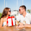 Smiling couple with gift box cafe — Stock Photo #51618345
