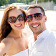 Smiling couple wearing sunglasses making selfie — Stock Photo #51618597