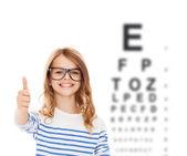 Little girl with black eyeglasses — Stock Photo
