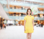 Smiling little girl in yellow dress — Foto Stock