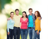 Group of smiling teenagers over green background — Stock Photo