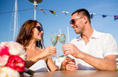 Smiling couple drinking champagne at cafe — Stock Photo