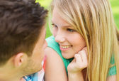 Smiling couple looking at each other in park — Stock Photo