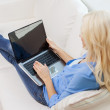 Smiling woman with laptop computer at home — Stock Photo #51620117