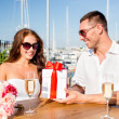 Smiling couple with gift box cafe — Stock Photo #51648441