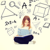 Student girl studying and reading book — Stock Photo
