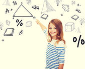 Girl pointing to triangle on virtual screen — Stock Photo