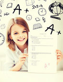 Girl with test and A grade at school — Stock Photo