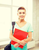 студент девушка с мешок школы и цвет папки — Стоковое фото