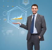 Businessman showing graph on virtual screen — Stock Photo