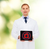 Smiling male doctor with tablet pc — Stock Photo