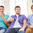 Happy male friends watching tv at home — Stock Photo #51692367