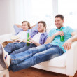 Happy male friends with beer watching tv at home — Stock Photo #51692407