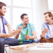 Five smiling teenagers eating pizza at home — Stock Photo #51693015