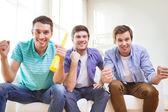 Happy male friends with vuvuzela — Stock Photo