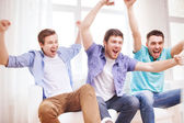 Happy male friends at home — Stock Photo