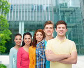 Group of smiling teenagers over city background — Stock Photo
