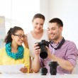 Smiling team with photocamera working in office — Stock Photo #51783719