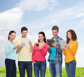 Group of teenagers with smartphones and tablet pc — Foto de Stock