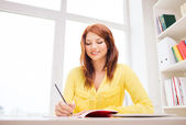 Smiling businesswoman or student with tablet pc — Stock Photo