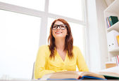 Young woman reading book at school — Stock Photo