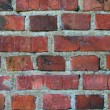 Old weathered stained red brick wall — Foto Stock