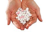 White round pills on hand — Stock Photo