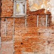 Old gungy wall with immured window — Stock Photo