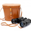 Black binoculars with orange cover — Stock Photo