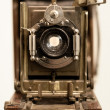 Front view of old wooden camera - Stock Photo