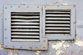Square windows with iron grating — Stock Photo