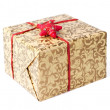 Golden gift box with red ribbon and star — Stock Photo #23214728