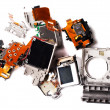 Broken compact digital camera parts prepared. - Stock Photo