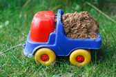 Toy car with sand — Stock Photo