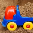 Toy truck with sand — Stock Photo
