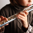 Girl playing flute — Stock Photo