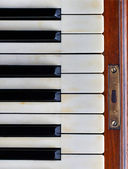 Piano keys of an old piano — Stock Photo