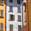 Colored walls and windows in the French city — Stock Photo