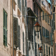 Lanterns hanging on a narrow street of the old French town — Стоковое фото